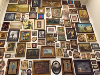 Up close wall of paintings