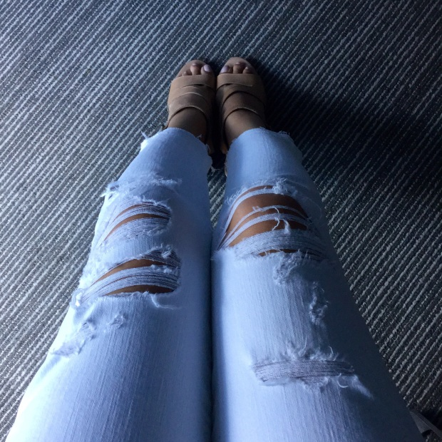 Ripped white jeans and nude shoes