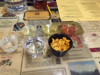 Wine samples and goldfish