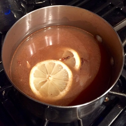 Spiced cider on stovetop mixed