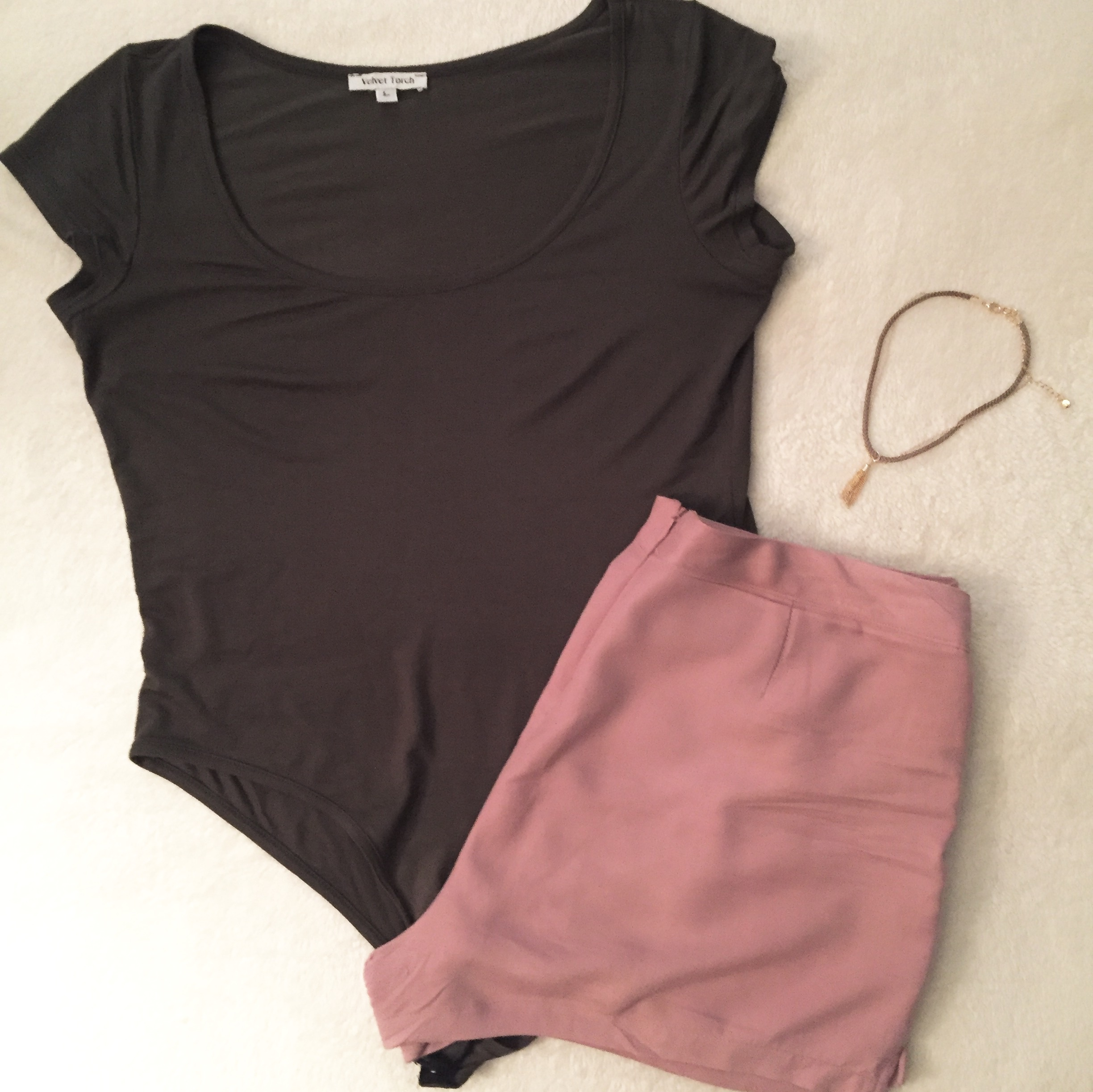 Olive green body suit and blush pink outfit