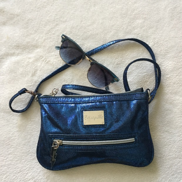 Blue purse and sunglasses